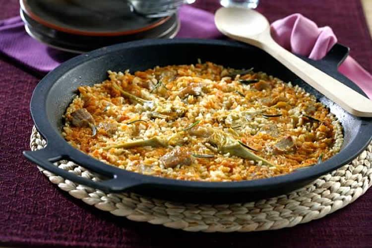 Paella con presa ibérica y alcachofas (Cocina Española)